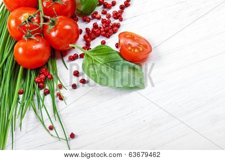 Tomatoes, chives, peppers, herbs on white