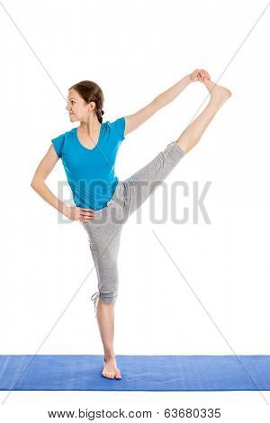 Yoga - young beautiful slender woman yoga instructor doing Extended Hand-To-Big-Toe Pose (Utthita Hasta Padangustasana) asana exercise isolated on white background