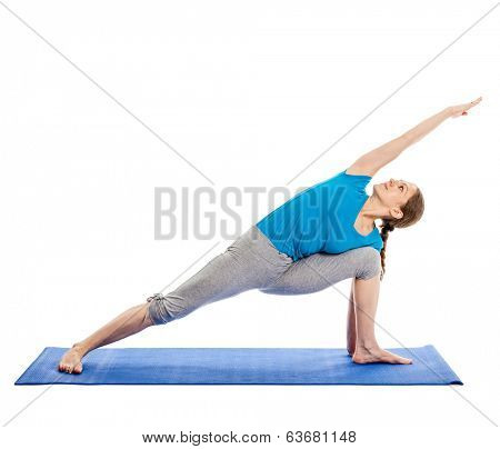 Yoga - young beautiful slender woman yoga instructor doing Extended Sides Angle Pose (Utthita Parsvakonasana) asana exercise isolated on white background