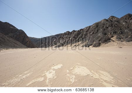 Dry River Valley In Desert Mountains