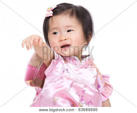Chinese babby girl hand up and point to front