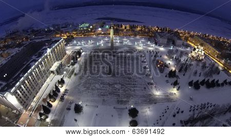 RUSSIA, SAMARA - JAN 1, 2014: Aerial view to Church of St George on the hill and Glory Monument on Glory Square in the evening.