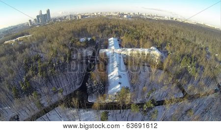 RUSSIA, MOSCOW - JAN 24, 2014: Aerial view to Tuberculosis Hospital in the form of aircraft surrounded by trees in winter