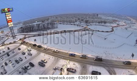 RUSSIA, SAMARA - JAN 5, 2014: Aerial view to Koshelev project with identical houses near superstore Mega in the evening.