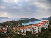 foto of nasty  - The view over the Cukurbag peninsula in Kas Turkey and Kastelorizo island on a cloudy nasty day taken in November 2013 - JPG