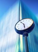 image of pass-time  - Passing time street clock  with bussines center - JPG