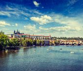 Vintage retro hipster style travel image Vltava river and Gradchany (Prague Castle), St. Vitus Cathe