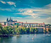 Vintage retro hipster style travel image of panorama view of Vltava river, Gradchany (Prague Castle)