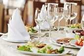 stock photo of catering  - catering services background with snacks and glasses of wine on bartender counter in restaurant - JPG