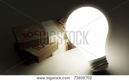 Lightbulb with money stack