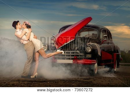 Young couple  next retro car  in smoke