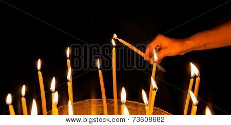 Man Lights A Candle In The Church