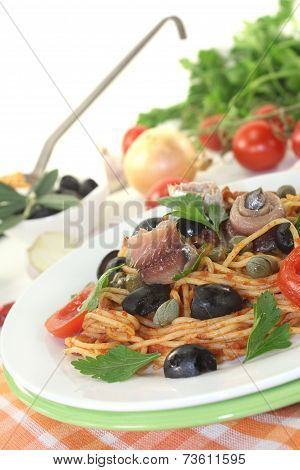 Spaghetti Alla Puttanesca With Olives And Anchovies
