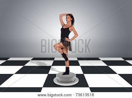 Beautiful dancer posing and looking at camera