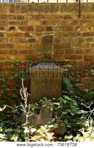 weathered grave with Broken Tomb
