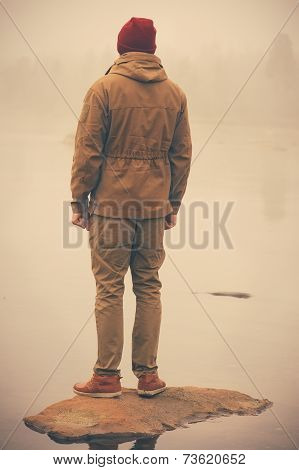 Young Man standing alone outdoor