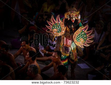 BALI, INDONESIA - SEPTEMBER 19, 2014: Characters from the Hindu mythology Ramayana appear in a staged presentation of the traditional Balinese Kecak Fire Dance held at the Uluwatu Temple in Bali.