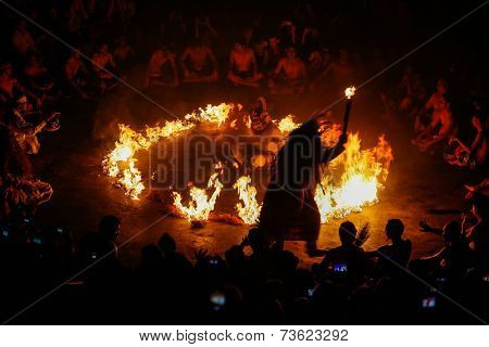 BALI, INDONESIA - SEPTEMBER 19, 2014: Hanuman is set to be burnt alive during a performance of the traditional Balinese Kecak Fire Dance at the Uluwatu Temple in Bali.