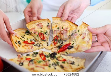 Image Of Friends Hands Taking Slices Of Pizza