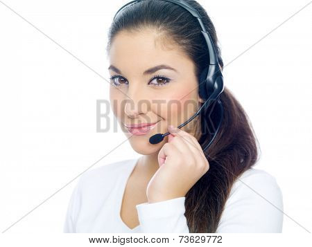 Friendly sexy young call center operator or receptionist wearing a headset smiling at the camera  isolated on white