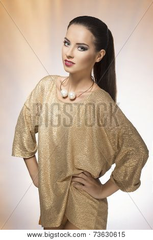 Young Woman In Spakling Gold Dress