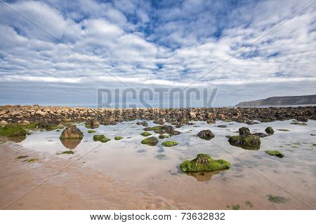 Beach With Rocks In The Sand At Cayton Bay, Uk