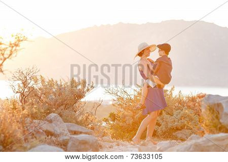 Loving Mother And Son Hugging Outdoors, Sunset