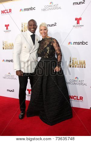 LOS ANGELES - OCT 10:  Terry Crews, Rebecca Crews at the 2014 NCLR ALMA Awards Arrivals at Civic Auditorium on October 10, 2014 in Pasadena, CA