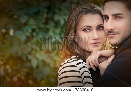 Young couple in love outdoor portrait