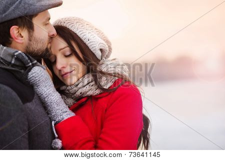 Winter couple hugging