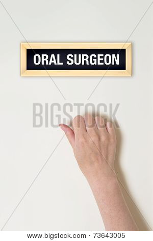 Female Hand Is Knocking On Oral Surgeon Door