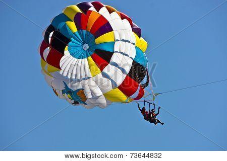 Young women parasailing.