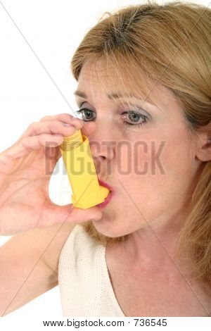Woman Using Asthma Inhaler 3