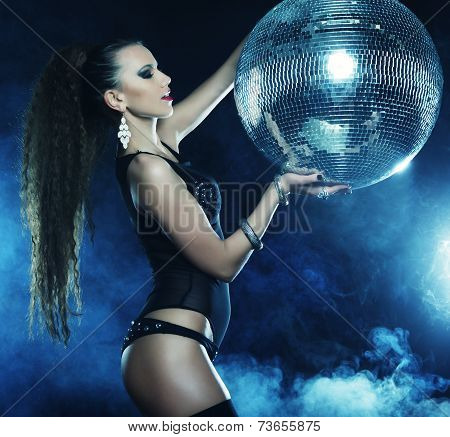 dancer girl in smoke with disco ball