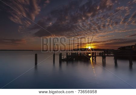Sunset Over A Jetty Near Brownsea Island In Poole Harbour