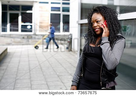 African Woman Talking On Her Mobile In The Street