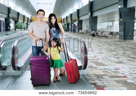 Family Stand In Airport Hall