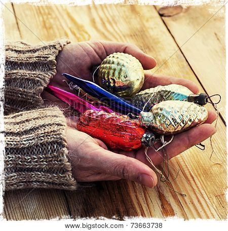 old Christmas glass toys in women's hands