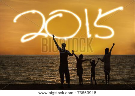 Silhouette Of Family Enjoy New Year
