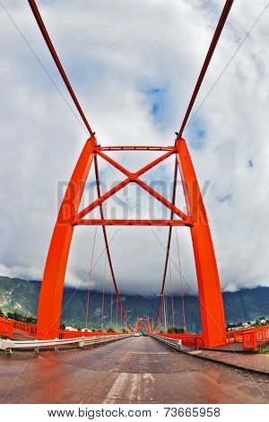 Red bridge over the fjord. Recently, there was a thunderstorm. Patagonia, Chile. The picture was taken Fisheye lens