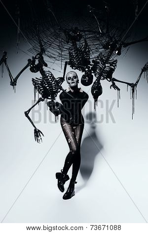 Scary Woman With Spider Web And Skeletons