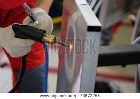 image of a man with a welding machine