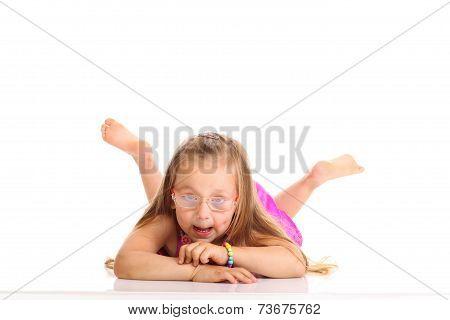 Cute Little Girl Lying On The Floor Doing Fun Isolated