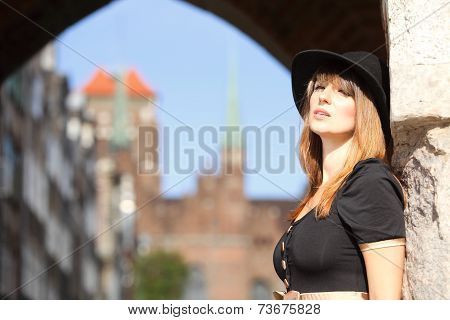 Retro Woman On Street Of Old Town Gdansk