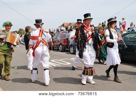 HASTINGS, ENGLAND - MAY 5, 2014: Musicians from Mad Jack's Morris perform in a parade on the West Hill during the annual Jack In The Green festival. The event marks the May Day holiday in Britain.