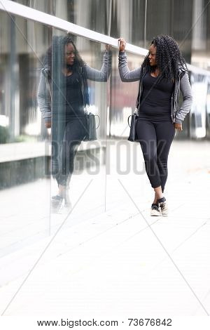 Trendy Young African Woman Admiring Her Reflection