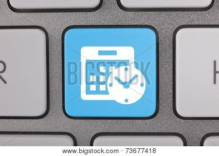 Blue White Calendar Icon on Keyboard