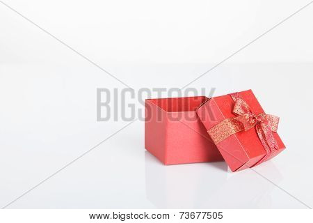 An Empty Red Gift Box With The Lid Off
