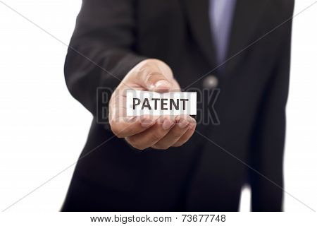 Man Holding Paper With Patent Text