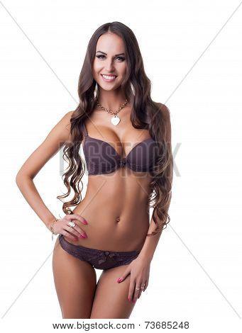 Seductive lingerie model smiling at camera